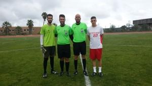 Dúo arbitral y capitanes de Educación ULL y Garimbita FC, durante la final del Trofeo Rector.